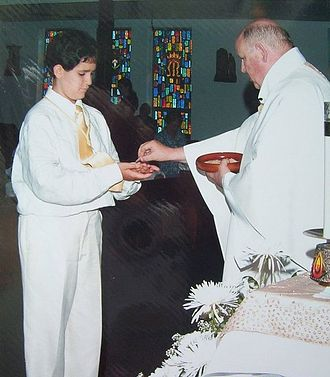 First Communion - A young boy receiving his First Communion in Florida.