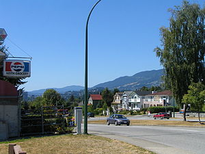 North Vancouver (city) - Keith Road looking west, with Hollyburn Mtn in the distance