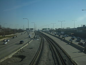Kennedy Expressway - Southeastward view of the Kennedy Expressway from the Montrose Blue Line Station, with the reversible express lanes to the right of the tracks