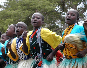 Culture of Kenya - Kenyan boys and girls performing a traditional dance.