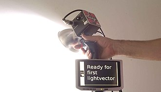 Keyer - A keyer for wearable computing, designed and built for making lightvector paintings.  Note the thumbwheel for cursor control and lightvector weight setting.  The keyer is designed to hold a video screen (below the keyer) and a photographic flash lamp (above the keyer).