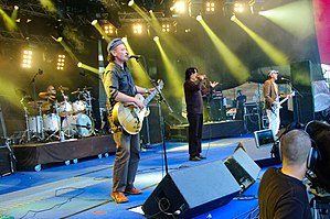Killing Joke performing at the 2009 Ilosaarirock Festival. From left to right: Ferguson (background), Walker, Coleman, Youth
