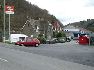 Knighton railway station - View from the road; the England-Wales border runs through the car park