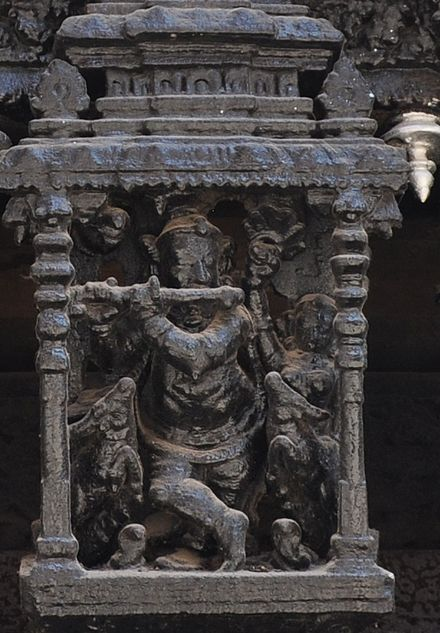 Temple car carving of Krishna playing flute, suchindram, Tamil Nadu, India Krishna flute suchindram temple car carving.jpg