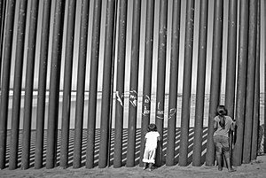 Imperial Beach, California - Children looking through the border fence on the Mexican side of Imperial Beach