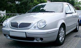https://upload.wikimedia.org/wikipedia/commons/thumb/e/ea/Lancia_Lybra_front_20070523.jpg/275px-Lancia_Lybra_front_20070523.jpg
