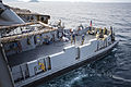 Landing Craft Utility 1666 exits well deck of USS Denver 140427-N-IC565-036.jpg