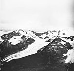 Langdon Glacier, terminus of mountain glacier with dark medial moraine, and hanging glaciers along the surrounding mountains (GLACIERS 6599).jpg