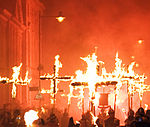 A photograph of people carrying flaming martyrs crosses in Lewes during the bonfire night celebration