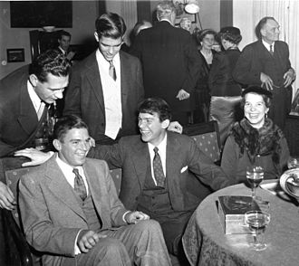 Linus Pauling - The Pauling children at a gathering in celebration of the 1954 Nobel Prizes in Stockholm, Sweden. Seated from left: Linus Pauling, Jr., Peter Pauling and Linda Pauling. Standing from left: an unidentified individual and Crellin Pauling