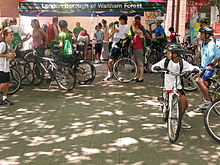 A group of people standing with their bicycles.