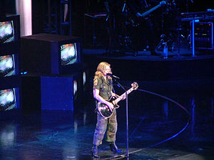 "Material Girl - Madonna performing ""Material Girl"" on the Re-Invention World Tour in 2004."