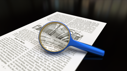 Magnifying glass with focus on paper