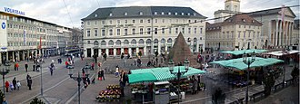 Pedestrian zone - Marktplatz in Karlsruhe, Germany, coexists with a tramline.