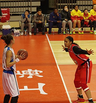 Women's Chinese Basketball Association - Shanxi Flame's Maya Moore defending an inbound pass from Shanghai Octopus's Huang Jing during a January 2014 WCBA game in Shanghai.