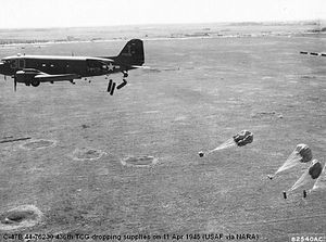 RAF Membury - Douglas C-47B-25-DK Skytrain Serial 44-76238 dropping supplies.