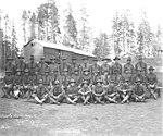 Members of the Spruce Division 431st Squad at camp no 6, Saginaw Timber Company, ca 1918 (KINSEY 541).jpeg