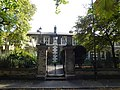 Mercers Cottages, Stepney - gate piers and overthrow 01.jpg