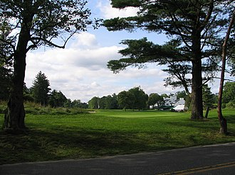 Merion Golf Club - Looking down the first fairway towards the clubhouse from Ardmore Avenue.