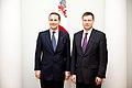 Ministru prezidents Valdis Dombrovskis tiekas ar Polijas ārlietu ministru Radoslavu Sikorski (8470089503).jpg