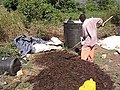 Mixing the compost heap manually (video) (6882092013).jpg