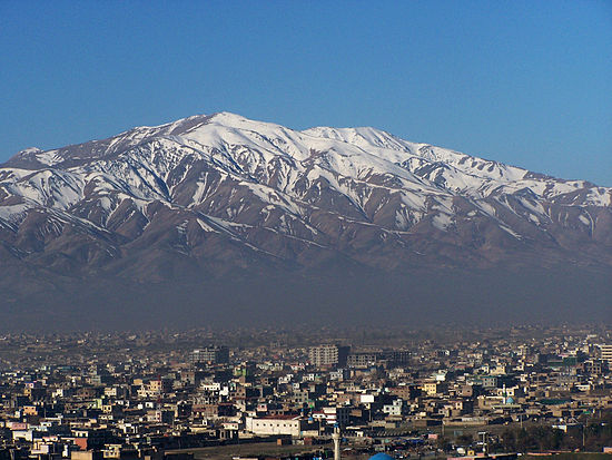Kabul, situated 5,900 feet (1,800 m) above sea level in a narrow valley, wedged between the Hindu Kush mountains Mountains of Kabul.jpg