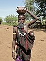 Mursi woman and her baby.jpg