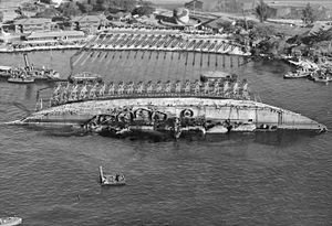 Parbuckle salvage - 19 March 1943, USS Oklahoma's parbuckle salvage. Ship rotated 90 degrees.