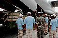 NDRF and IAF personnel supervising the off loading of relief materials at Leh.jpg