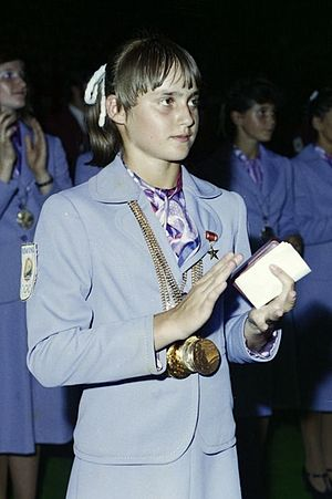 Nadia Comăneci - Comăneci displaying her medals