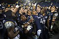 Navy celebrates their 44-28 victory over Pittsburgh in the 2015 Military Bowl. (23421080604).jpg