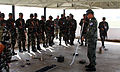 Nepalese soldiers with the Birendra Peace Operation Training Center receive a brief from Republic of Korea Army Capt. Jin Hak Jung, right, with the 11th Special Forces Brigade, at the vehicle checkpoint training 130807-M-DR618-001.jpg