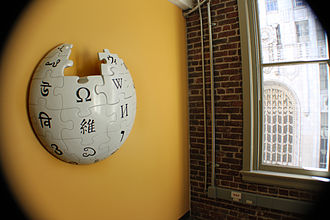 Wikipedia logo - A partial globe hangs in the Wikimedia office