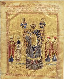 Seated figure on throne, crowned and dressed in blue and gold, flanked by four courtiers in red and, above the throne, two angel-like figures