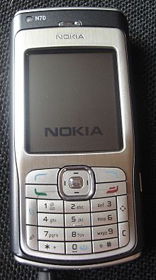 Nokia N70 with charger.jpg