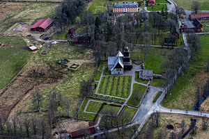 Nydala Abbey - Aerial view of the abbey. In the centre of the picture is the church and the renovated gatehouse chapel. To the left some ruins of the medieval abbey can be seen, while at the top of the picture Nydala Manor is discernible.