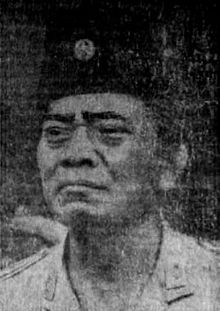 A three-quarter view portrait of General Urip Sumoharjo, the first chief of staff of the Indonesian National Armed Forces. He is wearing a peci hat, also called a songkok, and faces towards the viewer's left.