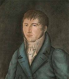 The portrait of a man wearing a coat and a shirt with a high collar.
