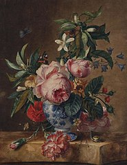Flower still life in a porcelain vase on a marble top