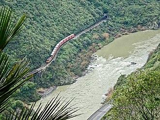 Palmerston North–Gisborne Line - Westbound train in Manawatu Gorge, viewed from White Horse Rapids lookout, Manawatu Gorge Track