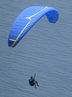 Paragliding Soaring with a paraglider