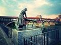 Pavia The Covered Bridge And Statue Washerwoman (178901921).jpeg
