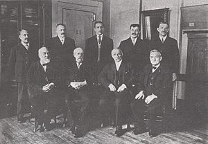 George T. Morgan - A photograph of the Mint engravers. Morgan is seated in the front row, second from right.