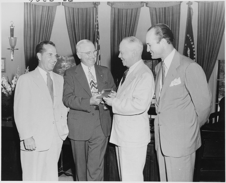 Fil:Photograph of President Truman in the Oval Office, receiving a gold pass to all games of the All-America Football... - NARA - 200170.tif