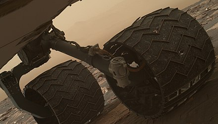 Curiosity's battered wheel after several years of exploration, 2017 Pia21486curiowheelpopping.jpg