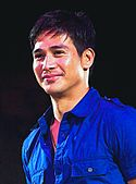 Piolo Pascual, wearing a blue polo shirt and smiles before audiences