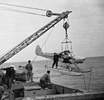 Piper PA-18 Super Cub on crane - Theb1936 - Flickr - NOAA Photo Library.jpg