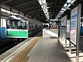 Platform of Osakako Station and train for Cosmosquare Station.jpg