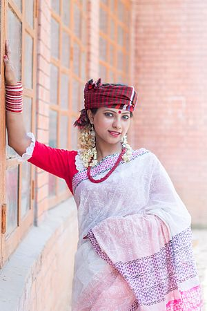 Bangladeshis - A Bangladeshi woman dressed in traditional attire during the Bengali New Year festival