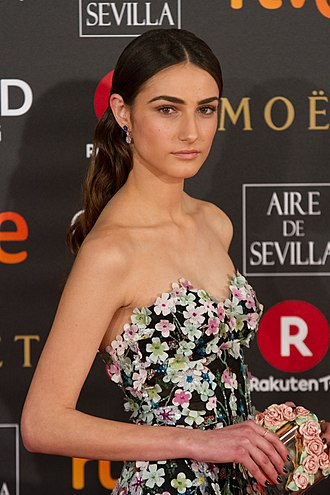Embellishment - Sandra Escacena wearing a dress with floral embellishments.